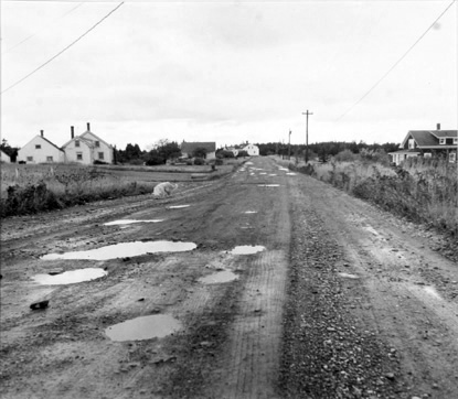 BERENICE ABBOTT Puddles in the Road (Matinicus), c. 1966, vintage silver gelatin photograph, 7 x 7 inches