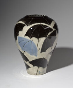 WILLIAM IRVINE A Shower of Umbrellas porcelain vase with Mark Bell, 10.5h x 8 inches $1600